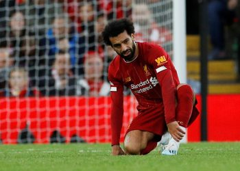 "Soccer Football - Premier League - Liverpool v Leicester City - Anfield, Liverpool, Britain - October 5, 2019  Liverpool's Mohamed Salah reacts after sustaining an injury REUTERS/Phil Noble  EDITORIAL USE ONLY. No use with unauthorized audio, video, data, fixture lists, club/league logos or ""live"" services. Online in-match use limited to 75 images, no video emulation. No use in betting, games or single club/league/player publications.  Please contact your account representative for further details."