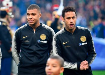 Paris Saint-Germain's French forward Kylian Mbappe (L) and Brazilian forward Neymar react as stand prior to the start of the French Cup final football match between Rennes (SRFC) and Paris Saint-Germain (PSG), on April 27, 2019 at the Stade de France in Saint-Denis, outside Paris. (Photo by Damien MEYER / AFP)        (Photo credit should read DAMIEN MEYER/AFP/Getty Images)