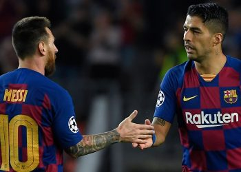 Barcelona's Uruguayan forward Luis Suarez (R) is congratulated by teammate Barcelona's Argentine forward Lionel Messi after scoring a goal during the UEFA Champions League Group F football match between Barcelona and Inter Milan at the Camp Nou stadium in Barcelona, on October 2, 2019. (Photo by LLUIS GENE / AFP) (Photo by LLUIS GENE/AFP via Getty Images)