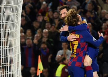 Barcelona's Argentine forward Lionel Messi (up) celebrates with teammate Barcelona's French forward Antoine Griezmann after scoring a goal during the UEFA Champions League Group F football match between FC Barcelona and Borussia Dortmund at the Camp Nou stadium in Barcelona, on November 27, 2019. (Photo by Josep LAGO / AFP) (Photo by JOSEP LAGO/AFP via Getty Images)