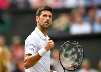 Tennis - Wimbledon - All England Lawn Tennis and Croquet Club, London, Britain - July 12, 2019  Serbia's Novak Djokovic reacts during his semi-final match against Spain's Roberto Bautista Agut  REUTERS/Toby Melville