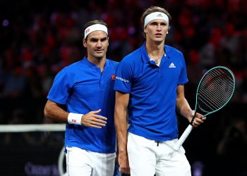 GENEVA, SWITZERLAND - SEPTEMBER 20: Roger Federer and Alexander Zverev of Team Europe look on during their doubles match against Jack Sock and Denis Shapovalov of Team World during Day One of the Laver Cup 2019 at Palexpo on September 20, 2019 in Geneva, Switzerland. The Laver Cup will see six players from the rest of the World competing against their counterparts from Europe. Team World is captained by John McEnroe and Team Europe is captained by Bjorn Borg. The tournament runs from September 20-22.  (Photo by Julian Finney/Getty Images for Laver Cup)