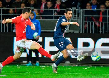 Paris Saint-Germain's Argentine midfielder Angel Di Maria (R) vies for the ball with Brest's French midfielder Julien Faussurier during the French L1 football match between Stade Brestois 29 and Paris Saint-Germain in Brest, western France, on November 9, 2019. (Photo by Damien MEYER / AFP) (Photo by DAMIEN MEYER/AFP via Getty Images)