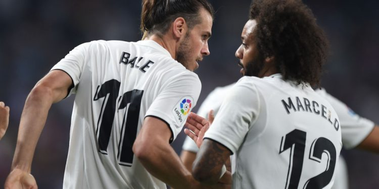 MADRID, SPAIN - AUGUST 19: Gareth Bale of Real Madrid celebrates with Marcelo after scoring his team's second goal during the La Liga match between Real Madrid CF and Getafe CF at Estadio Santiago Bernabeu on August 19, 2018 in Madrid, Spain. (Photo by Denis Doyle/Getty Images)