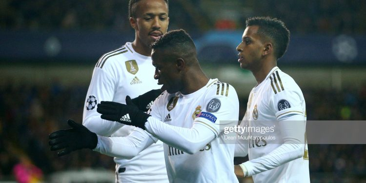 BRUGGE, BELGIUM - DECEMBER 11: Vinicius Junior of Real Madrid celebrates after scoring his team's second goal with Rodrygo of Real Madrid during the UEFA Champions League group A match between Club Brugge KV and Real Madrid at Jan Breydel Stadium on December 11, 2019 in Brugge, Belgium. (Photo by Dean Mouhtaropoulos/Getty Images)