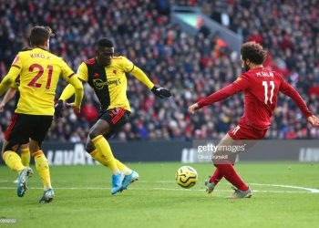 LIVERPOOL, ENGLAND - DECEMBER 14: Mohamed Salah of Liverpool scores his sides first goal during the Premier League match between Liverpool FC and Watford FC at Anfield on December 14, 2019 in Liverpool, United Kingdom. (Photo by Clive Brunskill/Getty Images)