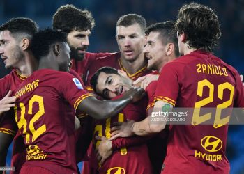 AS Roma's Armenian midfielder Henrik Mkhitaryan (C) celebrates with teammates after scoring during the Italian Serie A football match AS Roma vs Spal on December 15, 2019 at the Olympic stadium in Rome. (Photo by Andreas SOLARO / AFP) (Photo by ANDREAS SOLARO/AFP via Getty Images)