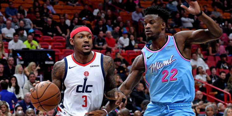 Dec 6, 2019; Miami, FL, USA; Washington Wizards guard Bradley Beal (3) dribbles the ball as Miami Heat forward Jimmy Butler (22) defends the play during the first half at American Airlines Arena. Mandatory Credit: Steve Mitchell-USA TODAY Sports