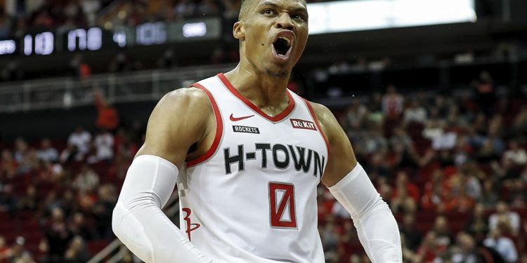 HOUSTON, TX - DECEMBER 07:  Russell Westbrook #0 of the Houston Rockets reacts after a basket in the fourth quarter against the Phoenix Suns at Toyota Center on December 7, 2019 in Houston, Texas.  NOTE TO USER: User expressly acknowledges and agrees that, by downloading and or using this photograph, User is consenting to the terms and conditions of the Getty Images License Agreement.  (Photo by Tim Warner/Getty Images)