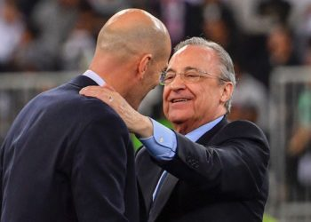Real Madrid's French coach Zinedine Zidane is congratulated by Real Madrid's President Florentino Perez after winning the Spanish Super Cup final between Real Madrid and Atletico Madrid on January 12, 2020, at the King Abdullah Sports City in the Saudi Arabian port city of Jeddah. (Photo by Giuseppe CACACE / AFP) (Photo by GIUSEPPE CACACE/AFP via Getty Images)