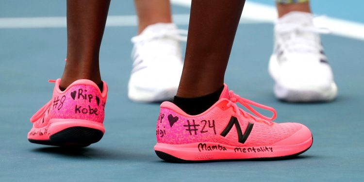 United States' Coco Gauff, front, and compatriot Caty McNally wear a tribute to Kobe Bryant on their shoes during their doubles match against Japan's Shuko Aoyama amd Ena Shibahara at the Australian Open tennis championship in Melbourne, Australia, Monday, Jan. 27, 2020. (AP Photo/Dita Alangkara)