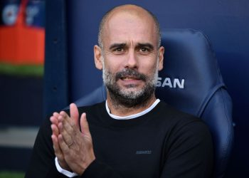 Manchester City's Spanish manager Pep Guardiola reacts ahead of the English Premier League football match between Manchester City and Tottenham Hotspur at the Etihad Stadium in Manchester, north west England, on August 17, 2019. (Photo by Oli SCARFF / AFP) / RESTRICTED TO EDITORIAL USE. No use with unauthorized audio, video, data, fixture lists, club/league logos or 'live' services. Online in-match use limited to 120 images. An additional 40 images may be used in extra time. No video emulation. Social media in-match use limited to 120 images. An additional 40 images may be used in extra time. No use in betting publications, games or single club/league/player publications. /         (Photo credit should read OLI SCARFF/AFP/Getty Images)