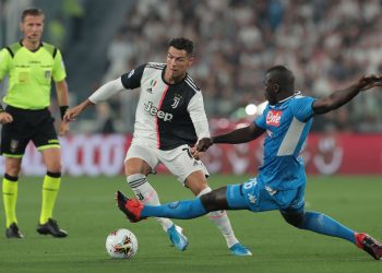 TURIN, ITALY - AUGUST 31:  Cristiano Ronaldo of Juventus is challenged by Kalidou Koulibaly of SSC Napoli during the Serie A match between Juventus and SSC Napoli at Allianz Stadium on August 31, 2019 in Turin, Italy.  (Photo by Emilio Andreoli/Getty Images )
