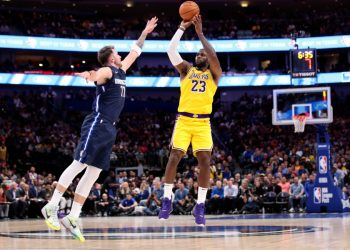 Nov 1, 2019; Dallas, TX, USA; Los Angeles Lakers forward LeBron James (23) shoots over Dallas Mavericks guard Luka Doncic (77) during the second half at American Airlines Center. Mandatory Credit: Kevin Jairaj-USA TODAY Sports