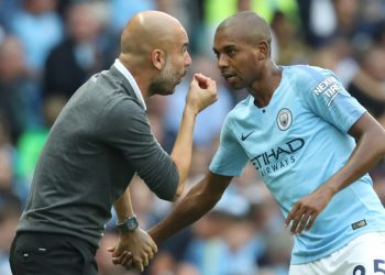 Manchester City's Spanish manager Pep Guardiola speaks with Manchester City's Brazilian midfielder Fernandinho during the English Premier League football match between Manchester City and Newcastle United at the Etihad Stadium in Manchester, north west England, on September 1, 2018. (Photo by Lindsey PARNABY / AFP) / RESTRICTED TO EDITORIAL USE. No use with unauthorized audio, video, data, fixture lists, club/league logos or 'live' services. Online in-match use limited to 120 images. An additional 40 images may be used in extra time. No video emulation. Social media in-match use limited to 120 images. An additional 40 images may be used in extra time. No use in betting publications, games or single club/league/player publications. /