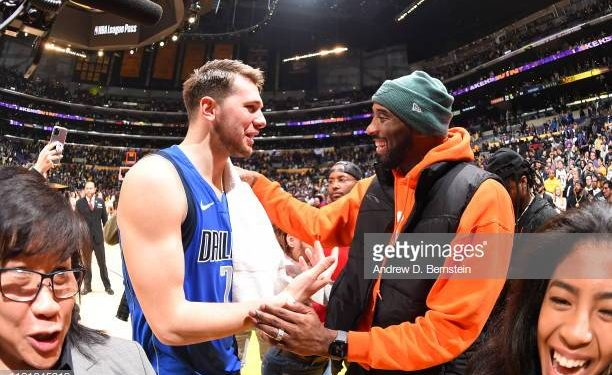 LOS ANGELES, CA - DECEMBER 29:  Luka Doncic #77 of the Dallas Mavericks and Kobe Bryant high five after the game against the Los Angeles Lakers on December 29, 2019 at STAPLES Center in Los Angeles, California. NOTE TO USER: User expressly acknowledges and agrees that, by downloading and/or using this Photograph, user is consenting to the terms and conditions of the Getty Images License Agreement. Mandatory Copyright Notice: Copyright 2019 NBAE (Photo by Andrew D. Bernstein/NBAE via Getty Images)