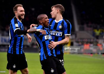 MILAN, ITALY - JANUARY 29:  (L-R) Nicolo Barella of Inter celebrates 2-1 with Ashley Young of Inter, Christian Eriksen of Inter  during the Italian Coppa Italia  match between Internazionale v Fiorentina at the San Siro on January 29, 2020 in Milan Italy (Photo by Mattia Ozbot/Soccrates/Getty Images)