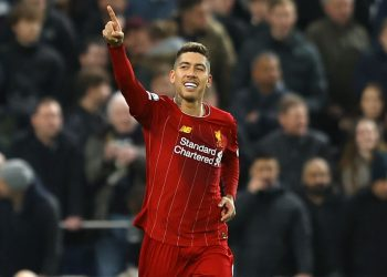 LONDON, ENGLAND - JANUARY 11: Roberto Firmino of Liverpool celebrates after scoring his team's first goal during the Premier League match between Tottenham Hotspur and Liverpool FC at Tottenham Hotspur Stadium on January 11, 2020 in London, United Kingdom. (Photo by Richard Heathcote/Getty Images)