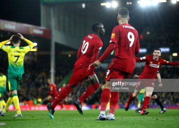 NORWICH, ENGLAND - FEBRUARY 15: Sadio Mane of Liverpool celebrates after scoring his team's first goal during the Premier League match between Norwich City and Liverpool FC at Carrow Road on February 15, 2020 in Norwich, United Kingdom. (Photo by Julian Finney/Getty Images)