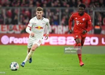 09 February 2020, Bavaria, Munich: Football: Bundesliga, Bayern Munich - RB Leipzig, 21st matchday in the Allianz Arena. Alphonso Davies (r) of Munich in action against Timo Werner of Leipzig. IMPORTANT NOTE: In accordance with the regulations of the DFL Deutsche Fußball Liga and the DFB Deutscher Fußball-Bund, it is prohibited to exploit or have exploited in the stadium and/or from the game taken photographs in the form of sequence images and/or video-like photo series. Photo: Matthias Balk/dpa (Photo by Matthias Balk/picture alliance via Getty Images)