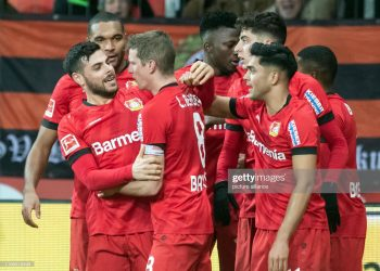 08 February 2020, North Rhine-Westphalia, Leverkusen: Football: Bundesliga, Bayer Leverkusen - Borussia Dortmund, 21st matchday in the BayArena. Leverkusen's Lars Bender (2nd from left) cheers with Kevin Volland about his goal for the 4th place in the 4.3. Photo: Bernd Thissen/dpa - IMPORTANT NOTE: In accordance with the regulations of the DFL Deutsche Fußball Liga and the DFB Deutscher Fußball-Bund, it is prohibited to exploit or have exploited in the stadium and/or from the game taken photographs in the form of sequence images and/or video-like photo series. (Photo by Bernd Thissen/picture alliance via Getty Images)