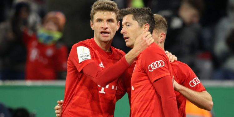 MUNICH, GERMANY - FEBRUARY 05: Robert Lewandowski of FC Bayern Munich celebrates with teammates Thomas Muller and Joshua Kimmich after scoring his team's fourth goal during the DFB Cup round of sixteen match between FC Bayern Muenchen and TSG 1899 Hoffenheim at Allianz Arena on February 05, 2020 in Munich, Germany. (Photo by Alexander Hassenstein/Bongarts/Getty Images)