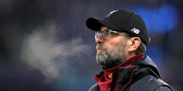 Liverpool manager Jurgen Klopp inspects the pitch before the UEFA Champions League match at the Red Bull Arena, Salzburg.