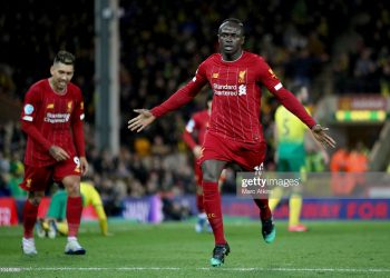 NORWICH, ENGLAND - FEBRUARY 15: Sadio Mane of Liverpool celebrates scoring the opening goal during the Premier League match between Norwich City and Liverpool FC at Carrow Road on February 15, 2020 in Norwich, United Kingdom. (Photo by Marc Atkins/Getty Images)