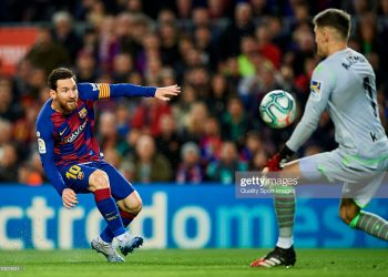 BARCELONA, SPAIN - MARCH 07: Lionel Messi of FC Barcelona competes for the ball with Alex Remiro of Real Sociedad during the Liga match between FC Barcelona and Real Sociedad at Camp Nou on March 07, 2020 in Barcelona, Spain.  (Photo by Silvestre Szpylma/Quality Sport Images/Getty Images)