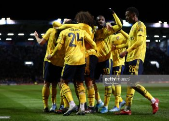 PORTSMOUTH, ENGLAND - MARCH 02: Sokratis Papastathopoulos of Arsenal celebrates with teammates after scoring their sides first goal during the FA Cup Fifth Round match between Portsmouth FC and Arsenal FC at Fratton Park on March 02, 2020 in Portsmouth, England. (Photo by Dan Istitene/Getty Images)