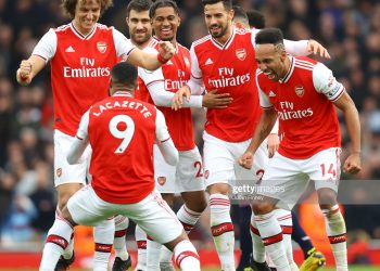 LONDON, ENGLAND - MARCH 07: Alexandre Lacazette of Arsenal celebrates with teammates after scoring his team's first goal which was given by VAR during the Premier League match between Arsenal FC and West Ham United at Emirates Stadium on March 07, 2020 in London, United Kingdom. (Photo by Julian Finney/Getty Images)