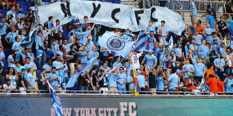 May 10, 2015; Harrison, NJ, USA; Fans of New York City FC cheer their team during pregame warmups prior to the game against the New York Red Bulls at Red Bull Arena. Mandatory Credit: Andy Marlin-USA TODAY Sports