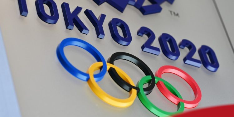 TOPSHOT - The logo for the Tokyo 2020 Olympic Games is seen in Tokyo on March 15, 2020. (Photo by CHARLY TRIBALLEAU / AFP)
