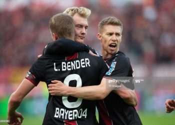 LEVERKUSEN, GERMANY - OCTOBER 20: Lars Bender of Bayer 04 Leverkusen, Julian Brandt of Bayer 04 Leverkusen and Mitchell Weiser of Bayer 04 Leverkusen celebrate their team`s goal during the Bundesliga match between Bayer 04 Leverkusen and Hannover 96 at BayArena on October 20, 2018 in Leverkusen, Germany. (Photo by TF-Images/Getty Images)