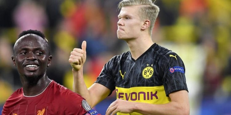 Dortmund's Erling Braut Haaland gives thumbs up at the end of the Champions League round of 16 first leg soccer match between Borussia Dortmund and Paris Saint Germain in Dortmund, Germany, Tuesday, Feb. 18, 2020. (AP Photo/Martin Meissner)