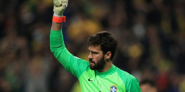 PORTO ALEGRE, BRAZIL - JUNE 27: Alisson Becker of Brazil celebrates after saving a penalty during the shootout after the Copa America Brazil 2019 quarterfinal match between Brazil and Paraguay at Arena do Gremio on June 27, 2019 in Porto Alegre, Brazil. (Photo by Buda Mendes/Getty Images)