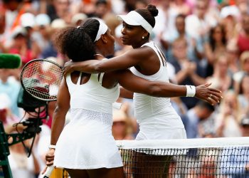 LONDON, ENGLAND - JULY 06:  Serena Williams of the United States hugs Venus Williams of the United States after their Ladies' Singles Fourth Round match  during day seven of the Wimbledon Lawn Tennis Championships at the All England Lawn Tennis and Croquet Club on July 6, 2015 in London, England.  (Photo by Julian Finney/Getty Images)