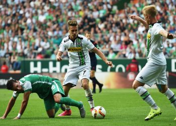 BREMEN, GERMANY - AUGUST 30:  Zlatko Junuzovic of Bremen is challenged by Oscar Wendt of Gladbach during the Bundesliga match between Werder Bremen and Borussia Moenchengladbach at Weserstadion on August 30, 2015 in Bremen, Germany.  (Photo by Stuart Franklin/Bongarts/Getty Images)