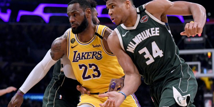 LOS ANGELES, CALIFORNIA - MARCH 06:  Giannis Antetokounmpo #34 of the Milwaukee Bucks attempts to get open as LeBron James #23 of the Los Angeles Lakers defends during the third quarter at Staples Center on March 06, 2020 in Los Angeles, California.  NOTE TO USER: User expressly acknowledges and agrees that, by downloading and or using this photograph, User is consenting to the terms and conditions of the Getty Images License Agreement.  (Photo by Harry How/Getty Images)