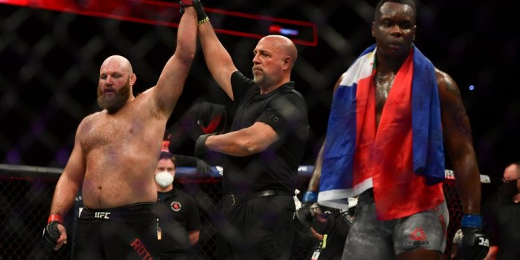 May 13, 2020; Jacksonville, Florida, USA; Ben Rothwell (red gloves) celebrates after defeating Ovince Saint Preux (blue gloves) during UFC Fight Night at VyStar Veterans Memorial Arena. Mandatory Credit: Jasen Vinlove-USA TODAY Sports