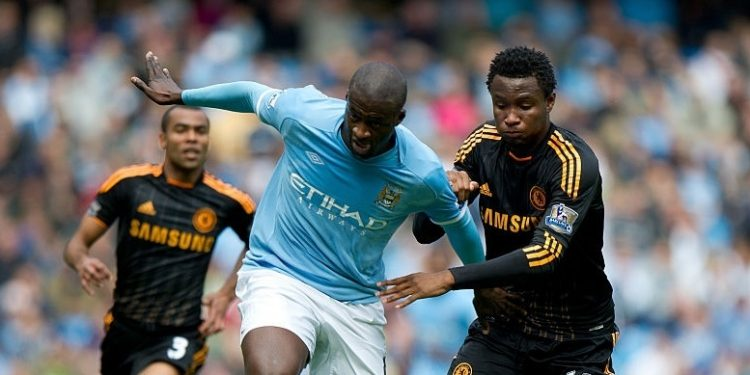 Yaya Toure of Manchester City and Mikel John Obi of Chelsea (Photo by AMA/Corbis via Getty Images)