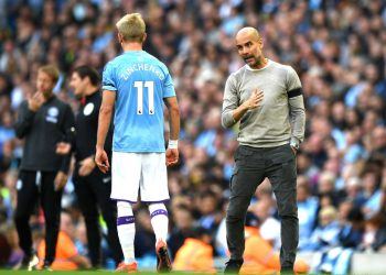 MANCHESTER, ENGLAND - AUGUST 31: Pep Guardiola, Manager of Manchester City speaks with Oleksandr Zinchenko of Manchester City during the Premier League match between Manchester City and Brighton & Hove Albion at Etihad Stadium on August 31, 2019 in Manchester, United Kingdom. (Photo by Shaun Botterill/Getty Images)