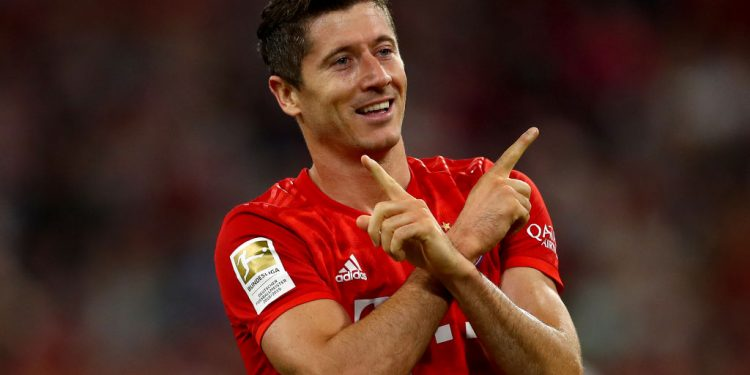 MUNICH, GERMANY - AUGUST 16: Robert Lewandowski of Muenchen celebrates after scoring his teams first goal during the Bundesliga match between FC Bayern Muenchen and Hertha BSC at Allianz Arena on August 16, 2019 in Munich, Germany. (Photo by Lars Baron/Bongarts/Getty Images)