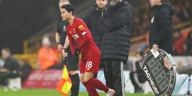 WOLVERHAMPTON, ENGLAND - JANUARY 23:  Takumi Minamino of Liverpool runs on to the pitch to make his premier league debut during the Premier League match between Wolverhampton Wanderers and Liverpool FC at Molineux on January 23, 2020 in Wolverhampton, United Kingdom. (Photo by Catherine Ivill/Getty Images)
