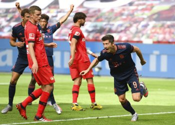Robert Lewandowski of Munich celebrates his team's fourth goal during the German Bundesliga soccer match between Bayer Leverkusen and Bayern Munich in Leverkusen, Germany, Saturday, June 6, 2020. (Matthias Hangst, Pool via AP)