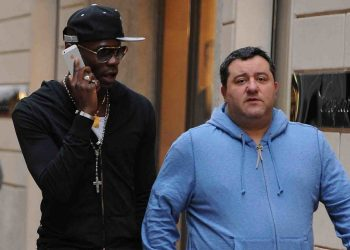 MILAN, ITALY - MARCH 05:  Mino Raiola (R) and Mario Balotelli are seen on March 5, 2013 in Milan, Italy.  (Photo by Jacopo Raule/Getty Images)
