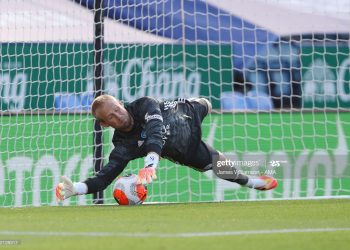 LEICESTER, ENGLAND - JUNE 23:  Kasper Schmeichel of Leicester City saves a penalty taken by Neal Maupay of Brighton and Hove Albion during the Premier League match between Leicester City and Brighton & Hove Albion at The King Power Stadium on June 23, 2020 in Leicester, United Kingdom. Football Stadiums around Europe remain empty due to the Coronavirus Pandemic as Government social distancing laws prohibit fans inside venues resulting in all fixtures being played behind closed doors. (Photo by James Williamson - AMA/Getty Images)