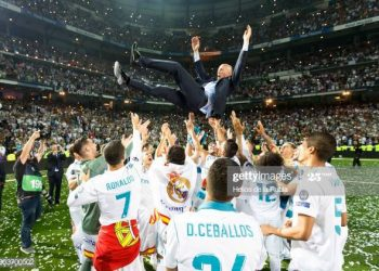 MADRID, SPAIN - MAY 27: Zinedine Zidane, Manager of Real Madrid is thrown in the air by his players during Real Madrid team celebration at Santiago Bernabeu Stadium after winning their 13th European Cup on May 27, 2018 in Madrid, Spain.(Photo by Helios de la Rubia/Real Madrid via Getty Images)