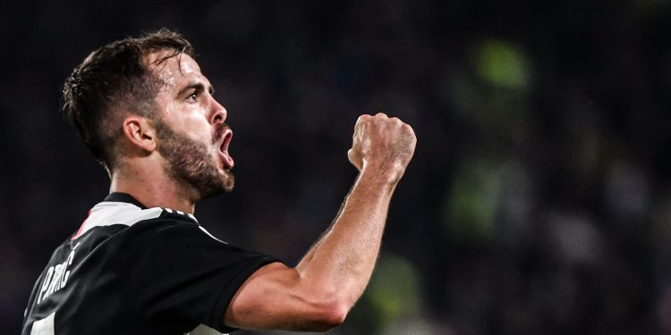 Juventus' Bosnian midfielder Miralem Pjanic celebrates after scoring during the Italian Serie A football match Juventus vs Bologna on October 19, 2019 at the Juventus stadium in Turin. (Photo by Marco Bertorello / AFP) (Photo by MARCO BERTORELLO/AFP via Getty Images)