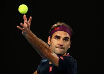 MELBOURNE, AUSTRALIA - JANUARY 24: Roger Federer of Switzerland serves during his Men's Singles third round match against John Millman of Australia on day five of the 2020 Australian Open at Melbourne Park on January 24, 2020 in Melbourne, Australia.  (Photo by Cameron Spencer/Getty Images)